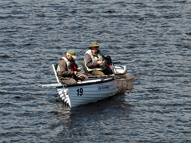 Two men in a fishing boat of Llyn Clywedog