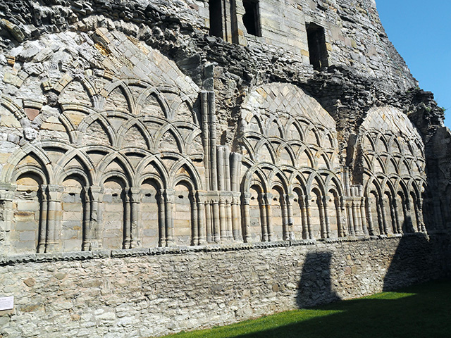 False arcading on the south wall of the chapter house.