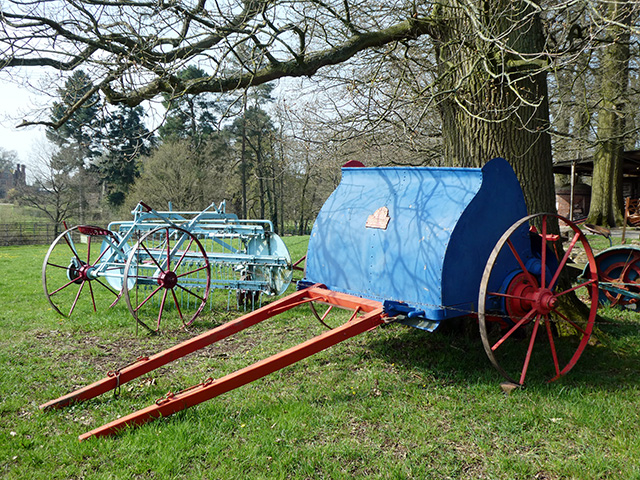 Historic farm machinery at Acton Scott.