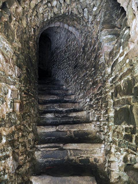 Up some dark stone stairs...