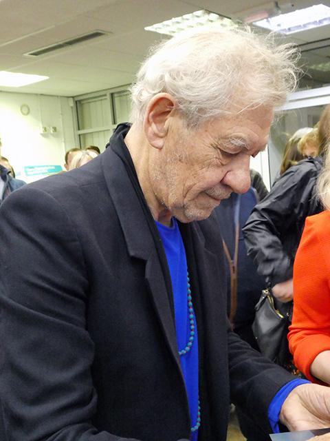 Ian McKellen signing programmes.