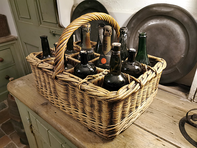 A wicker basket of bottles.