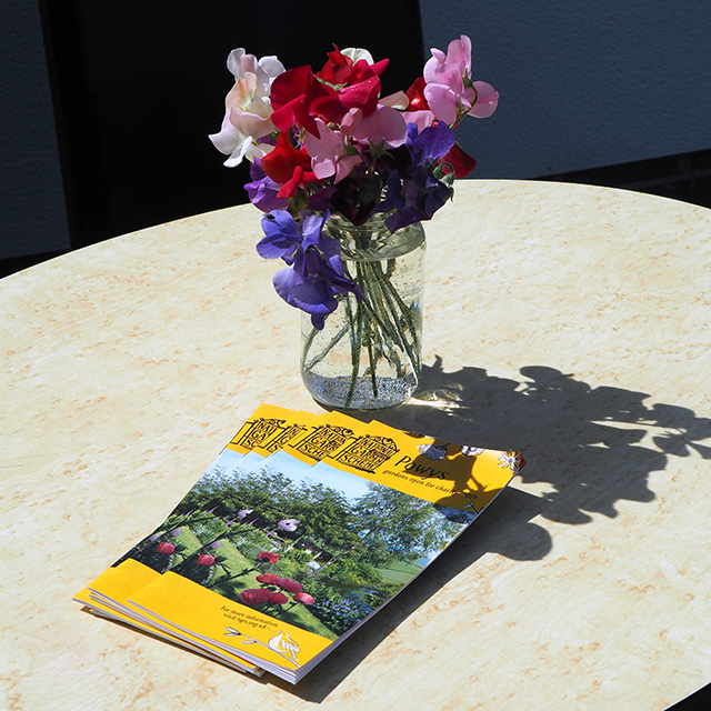 Cut flowers and the Powys National Garden Scheme booklets.