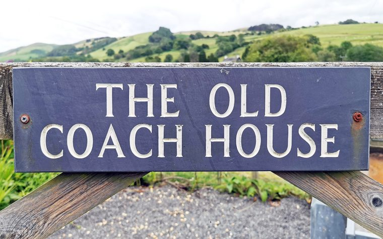 The Old Coach House sign