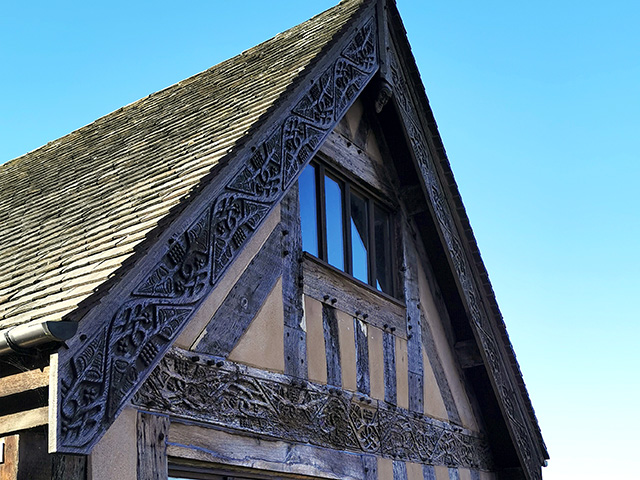 A closer look at the carvings on the timber frame of Riggs Hall.