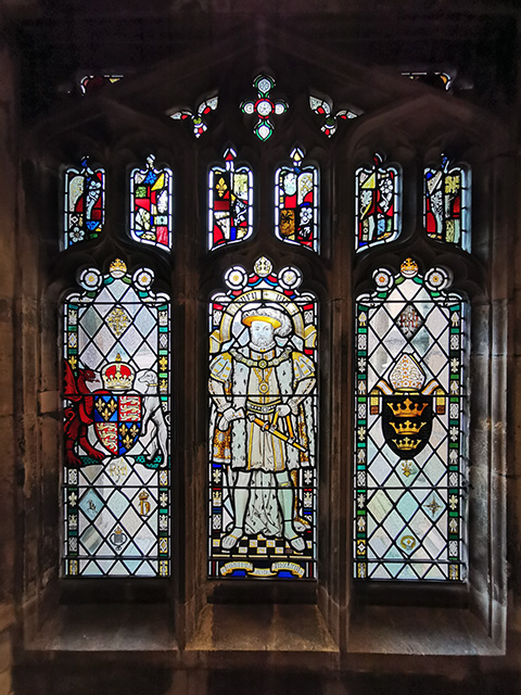 A stained glass window depicting Henry VIII.