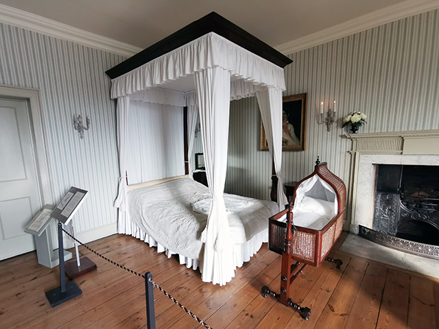 The Main Bedroom with a four-poster bed.