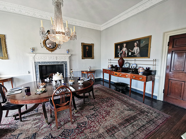The Eating Room - The dining table (dating from 1800 - 1820) is set for dessert with Bristol porcelain plates (c. 1775) and genuine Bristol Blue glass.