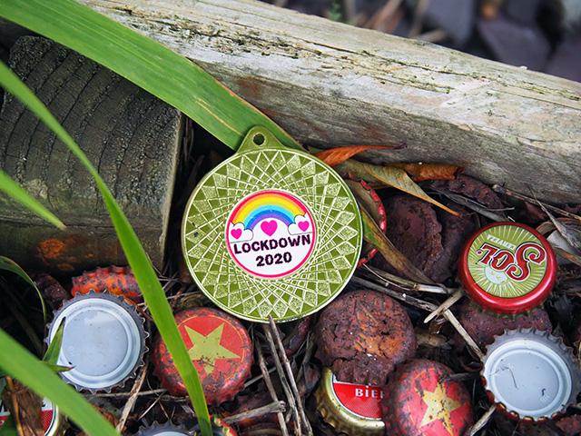 A Lockdown 2020 medal amongst the bottle caps.