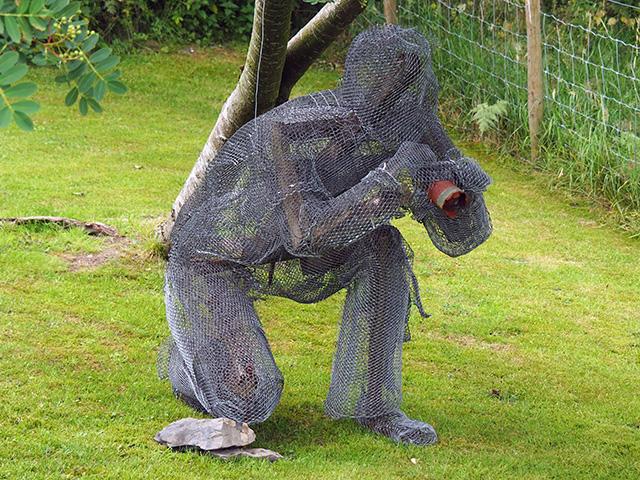 A sculpture of a photographer.