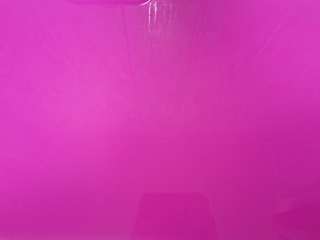 Vibrant pink bath water.