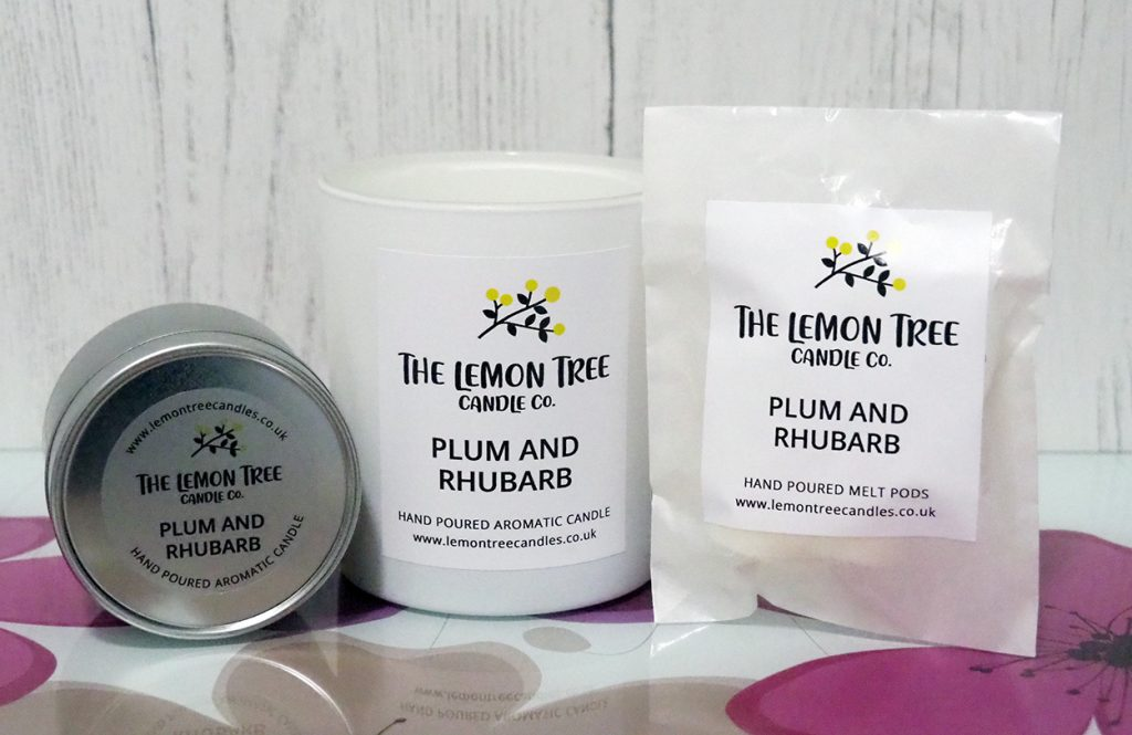 The Lemon Tree Candle Co. candle in a tin, large candle and wax melt pods.