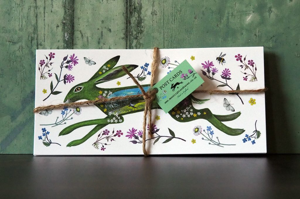 Floral Spring Hare Postcards tied with string.