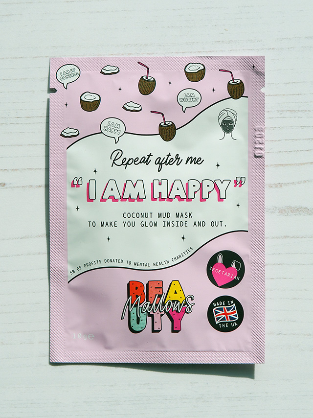 """Mallows Beauty Coconut Mud Mask with """"Repeat after me I AM HAPPY"""" slogan."""