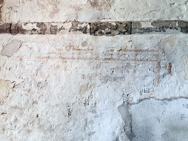 Part of an uncovered medieval wall painting.