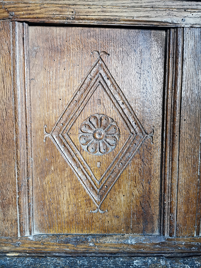 A wooden panel of one of the pews.