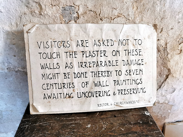 A sign asking people not to touch the walls.